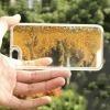 Etui z płynem w środku Stardust na iPhone 5 / 5s - złoty.